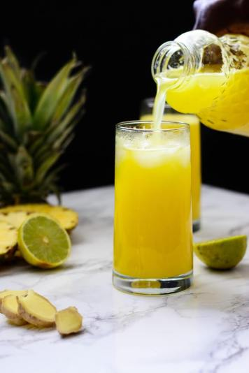 pineapple-ginger-juice-pouring-a-glass